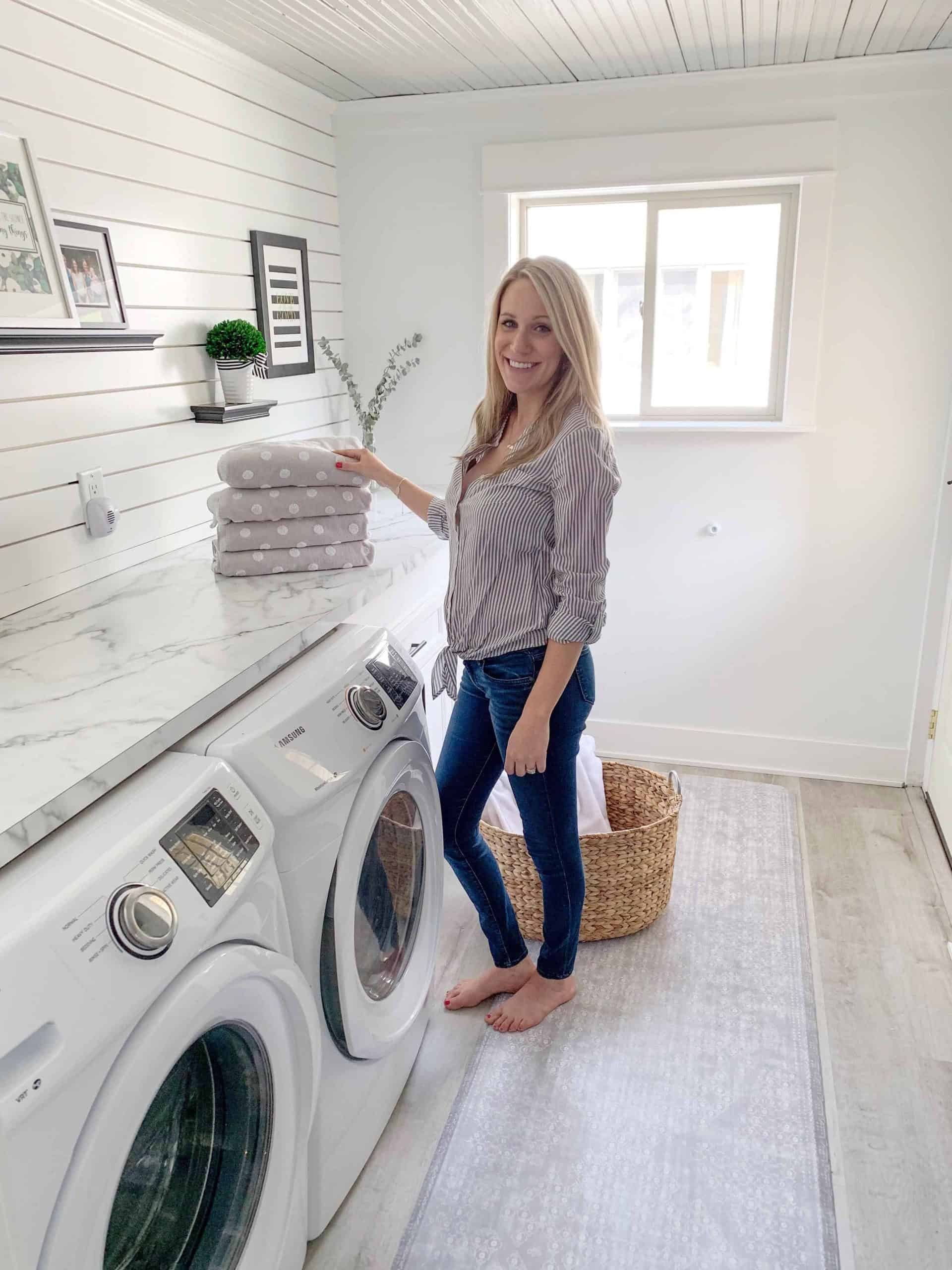 fashionable woman standing in laundry room