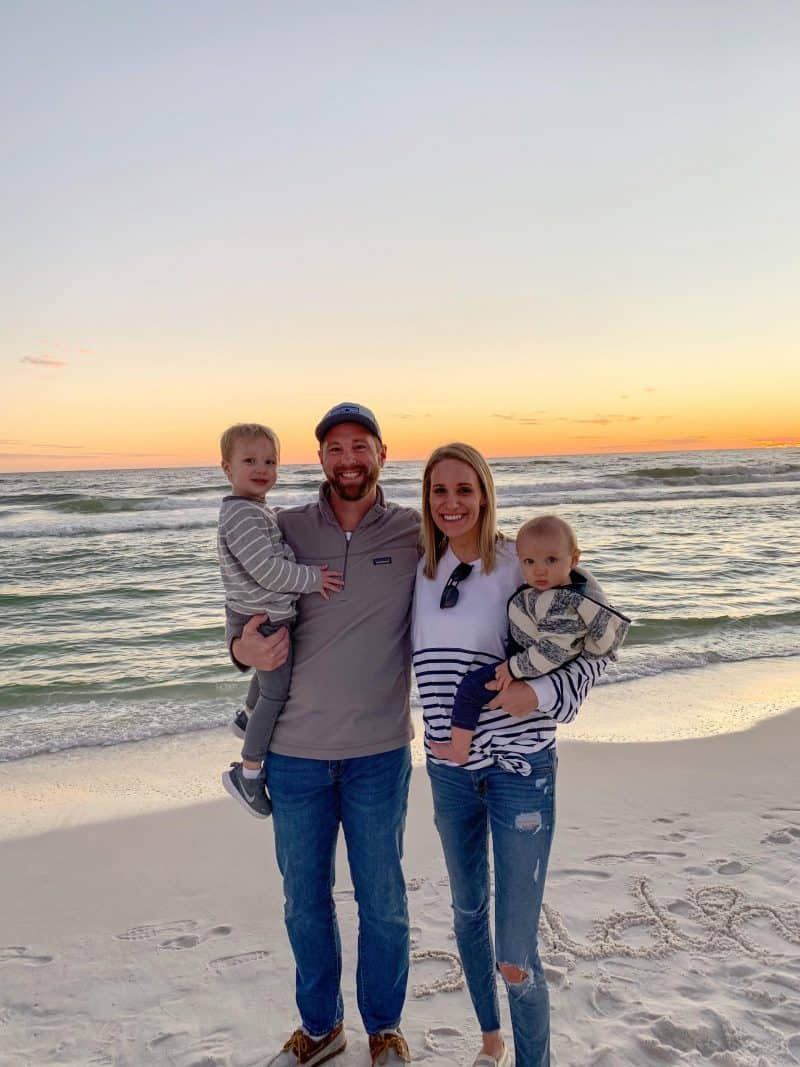 The Ultimate 30A Travel Guide for Families featured by top US travel blog, House of Navy: image of Family Photo at sunset on Florida beach
