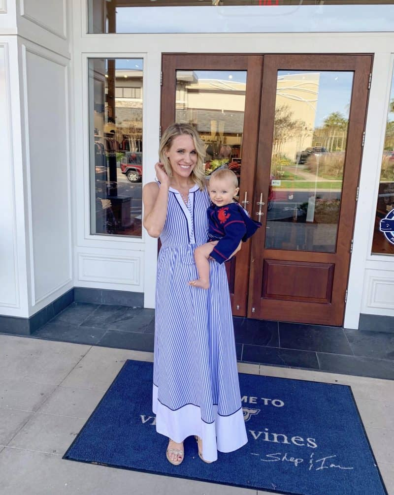 The Ultimate 30A Travel Guide for Families featured by top US travel blog, House of Navy: image of fashion blogger posing in preppy dress with son
