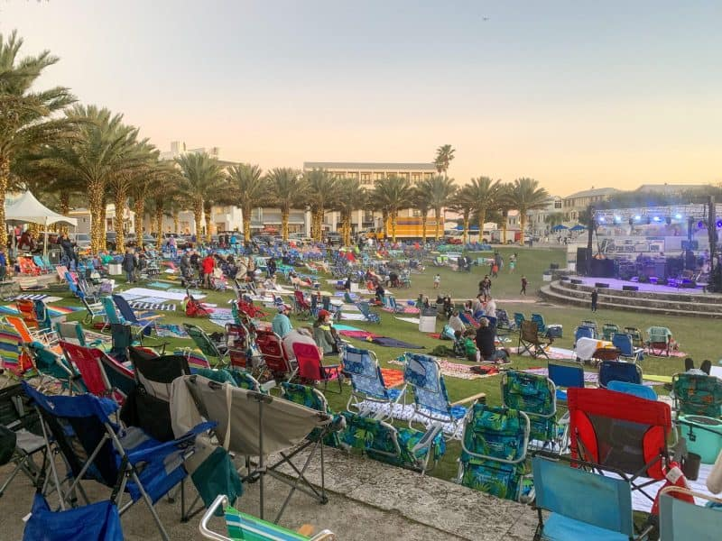 The Ultimate 30A Travel Guide for Families featured by top US travel blog, House of Navy: image of chairs at park for outdoor concert