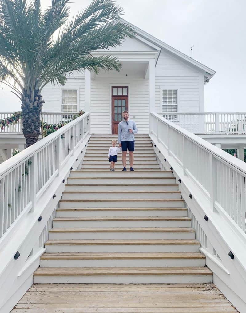The Ultimate 30A Travel Guide for Families featured by top US travel blog, House of Navy: image of father and son holding hands walking down stairs