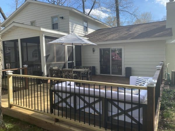 3 Ways to Focus on Community with MSHDA's Neighborhood Enhancement Program featured by top MI lifestyle blogger, House of Navy: photo of white house and deck after renovation