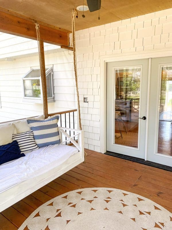 3 Ways to Focus on Community with MSHDA's Neighborhood Enhancement Program featured by top MI lifestyle blogger, House of Navy: covered patio with porch swing