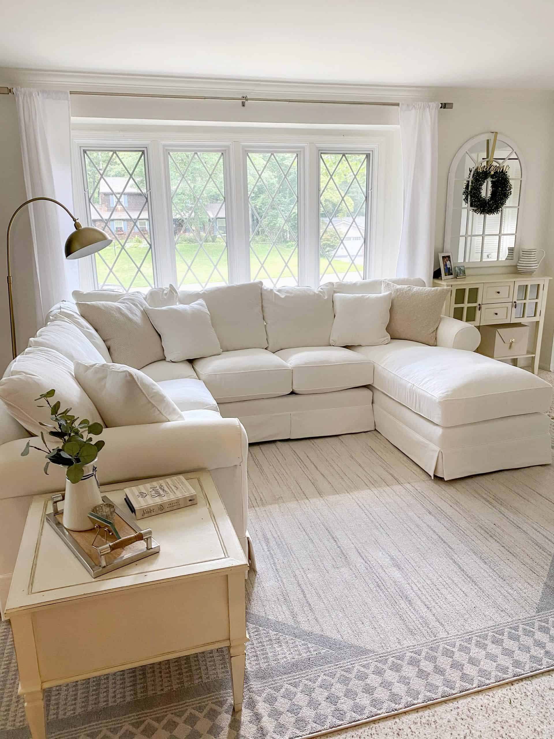9 Stunning Coastal Paint Colors For Your Home featured by top MI lifestyle blogger, House of Navy: white living room paint inspiration
