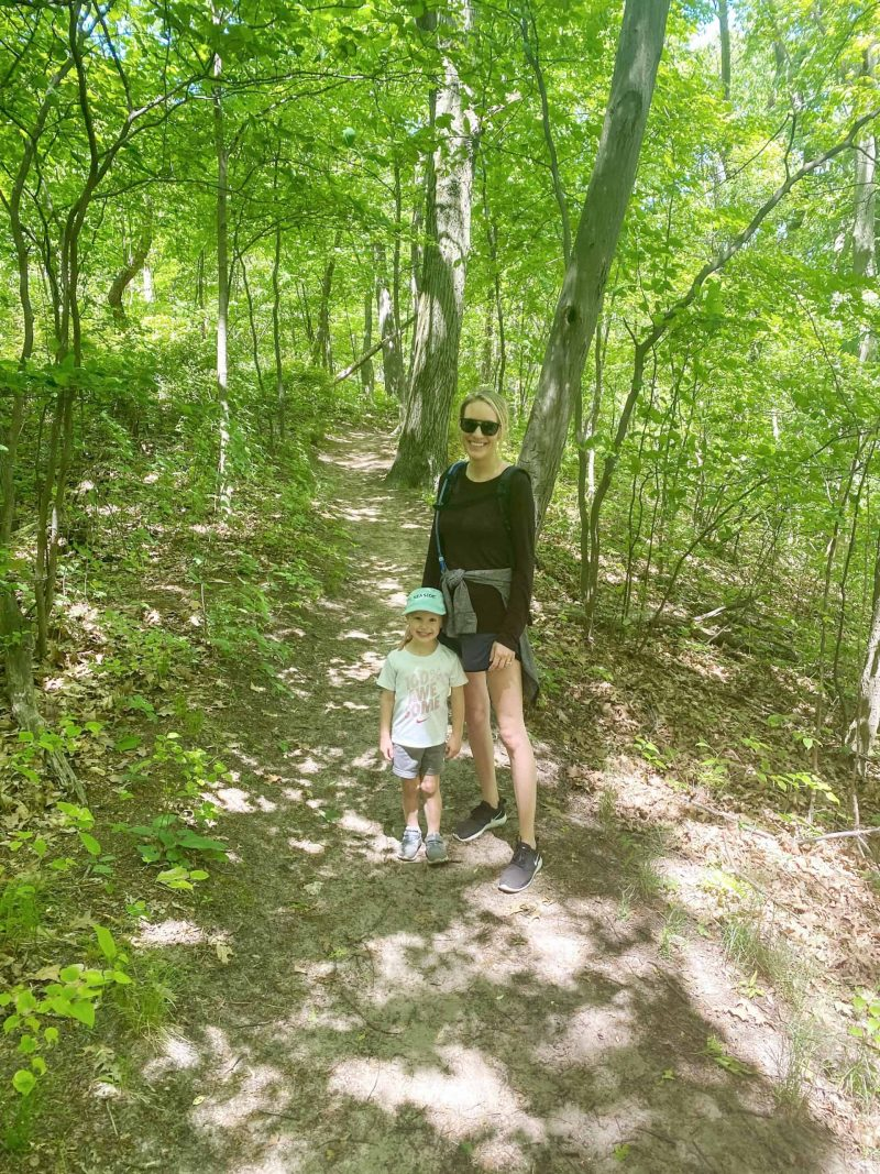 mother and son hiking | Living in Michigan by popular Michigan lifestyle blog, The House of Navy: image of a mom and son hiking in Holland, MI.