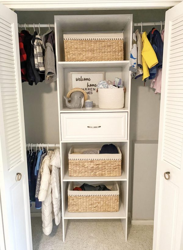 nursery closet |Nautical Nursery Decor by popular Michigan life and style blog, The House of Navy: image of a closet with neutral colored woven baskets and whale figurine.