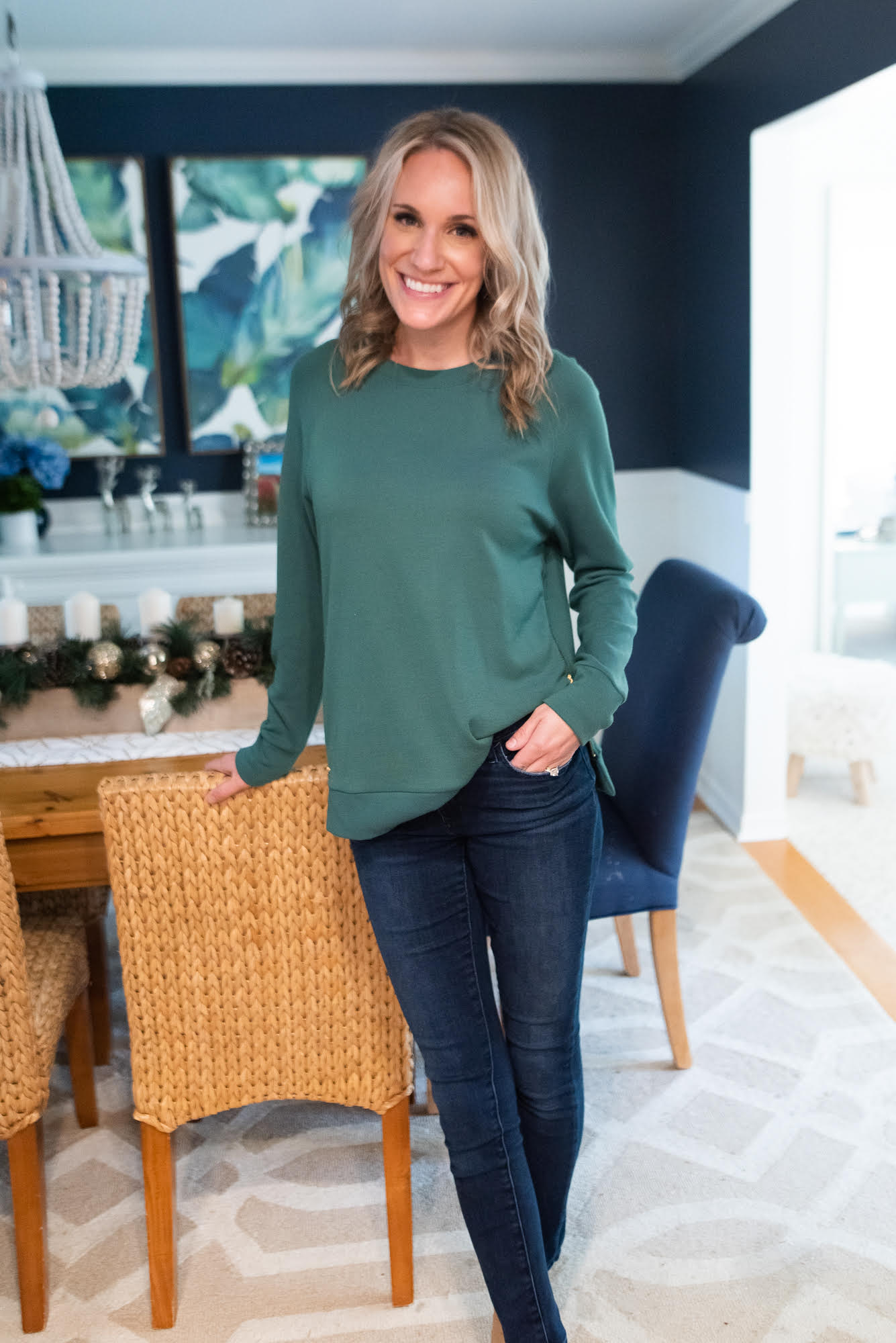 fashionable preppy mom |Fall Clothing by popular Michigan fashion blog, The House of Navy: image of a woman wearing the Duffield Lane Meghan Pullover with a pair of dark wash jeans.