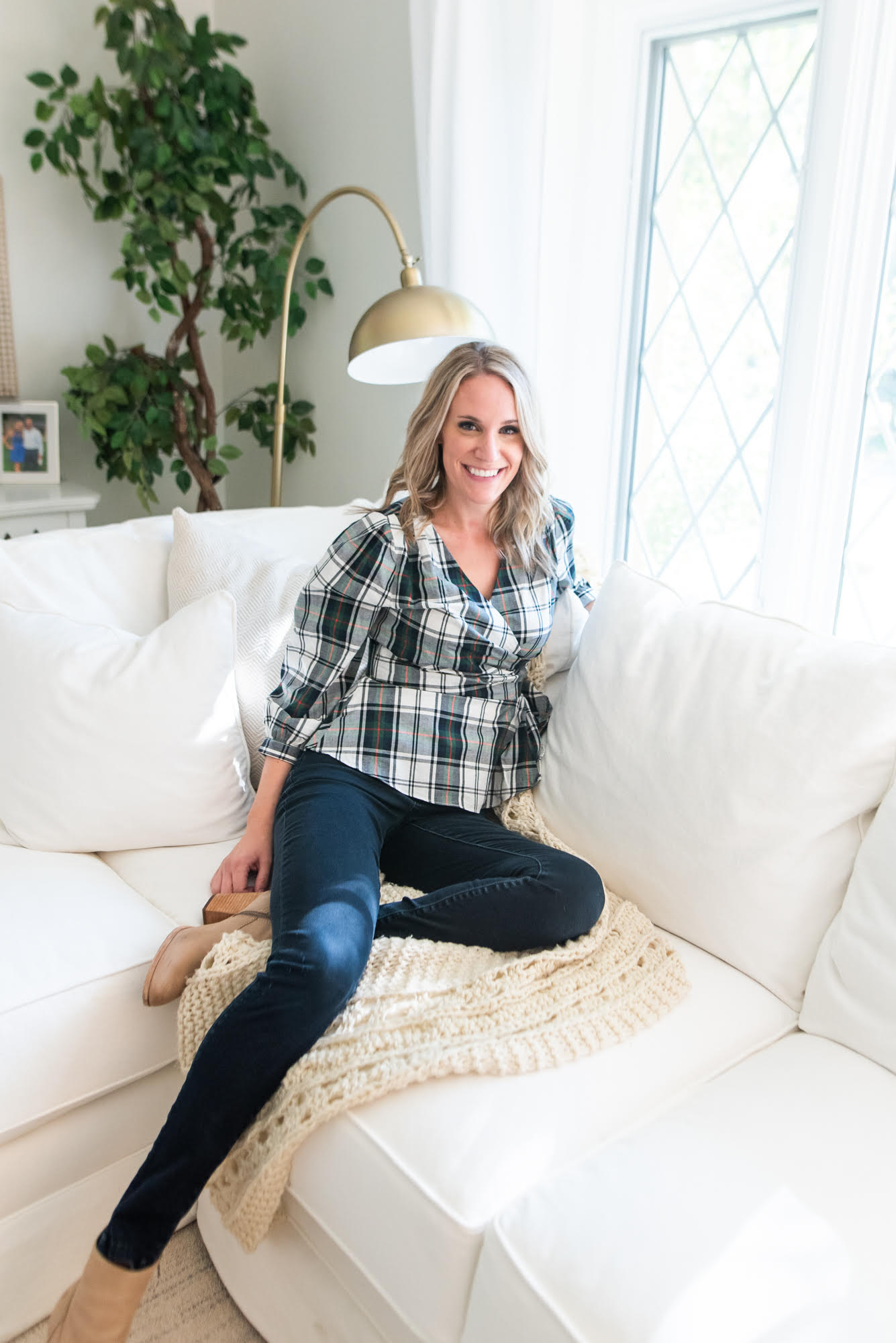 fashionable preppy mom in plaid shirt |Fall Clothing by popular Michigan fashion blog, The House of Navy: image of a woman wearing the Duffield Lane Rudy Top with a pair of dark wash jeans and tan suede ankle boots.