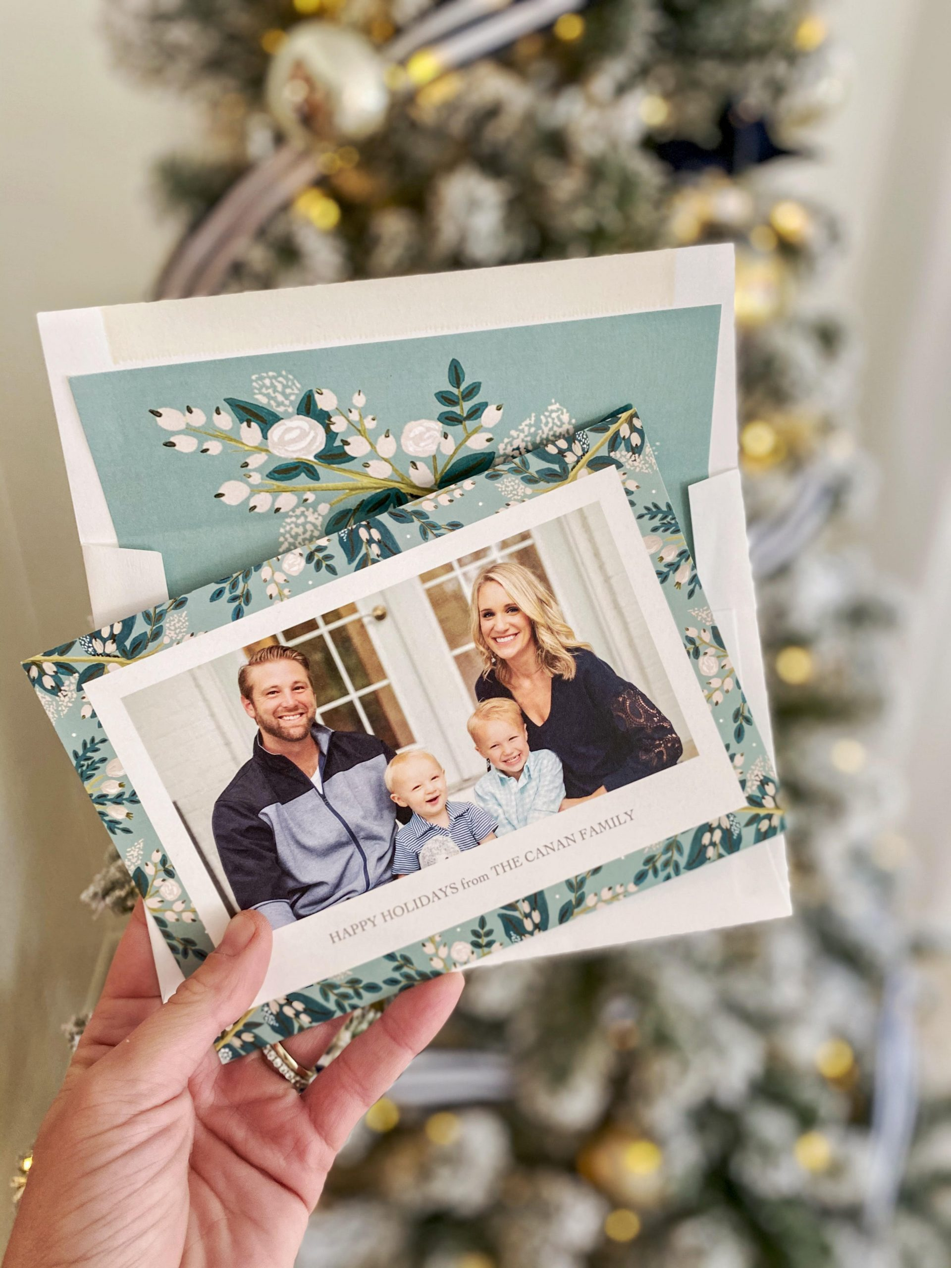 woman holding holiday card in her hand