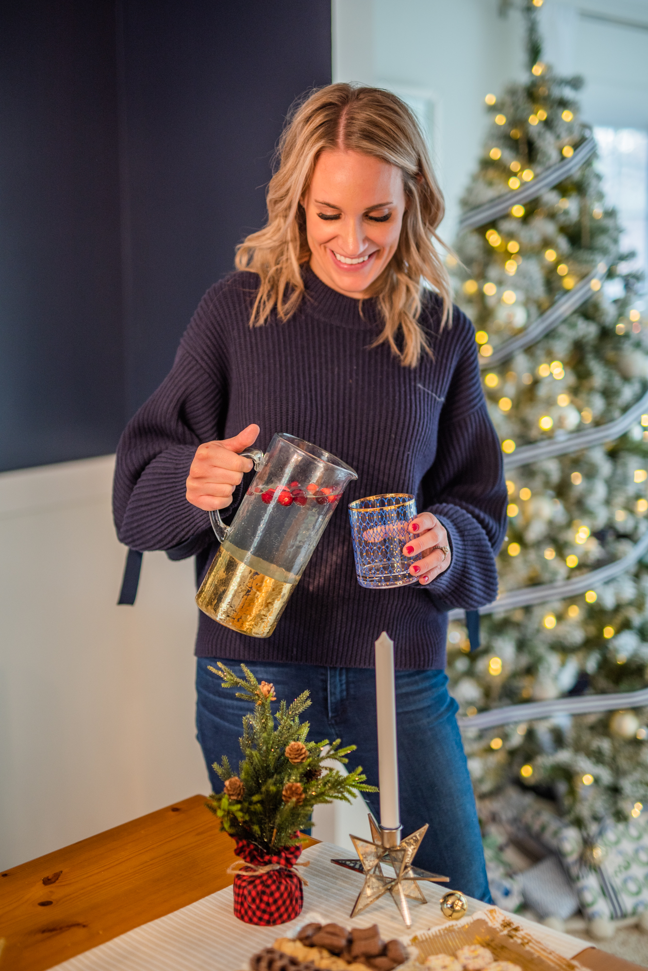 photo of woman pouring holiday drinks from pitcher