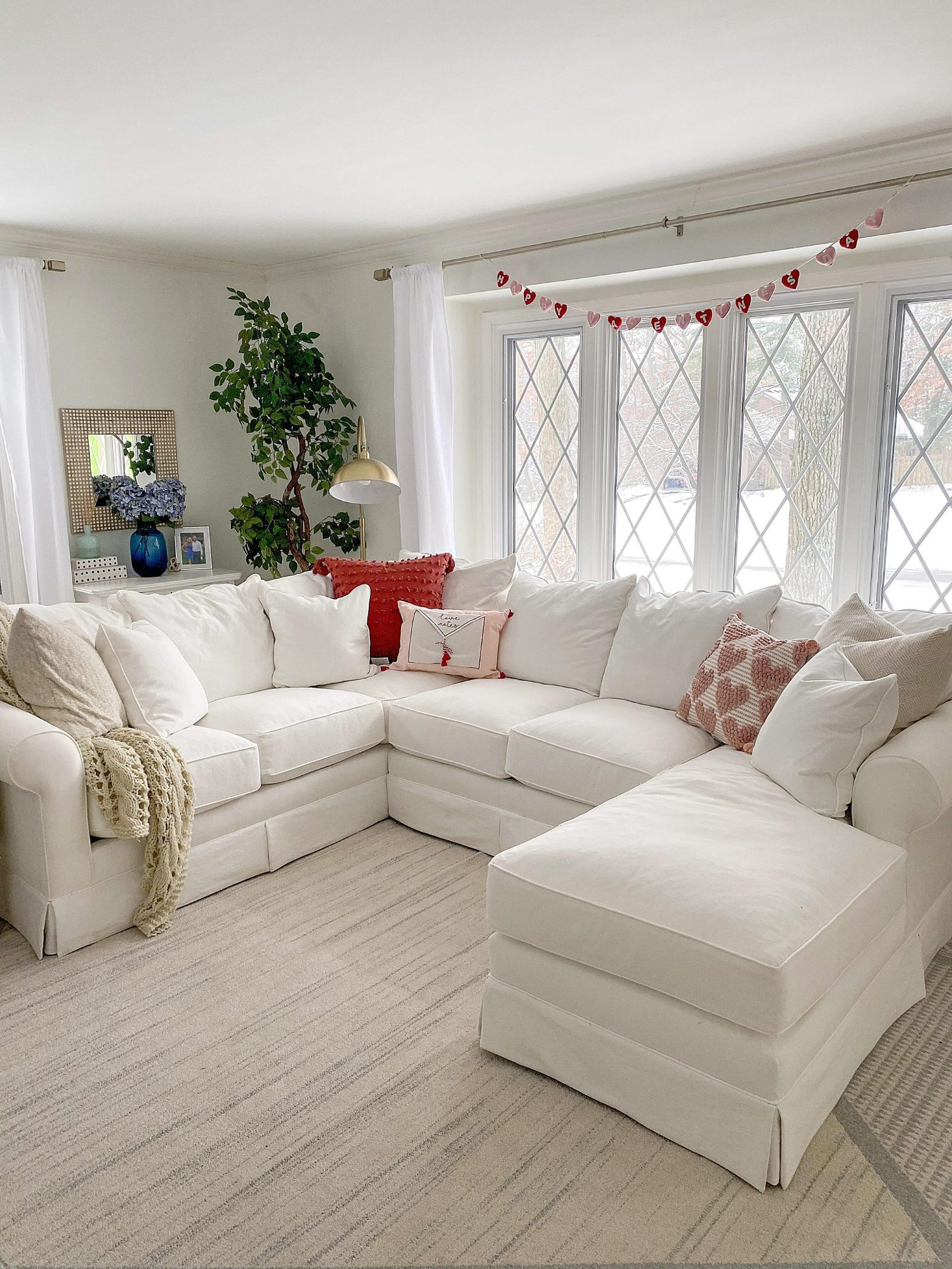 preppy living room decorated with valentine's day decor