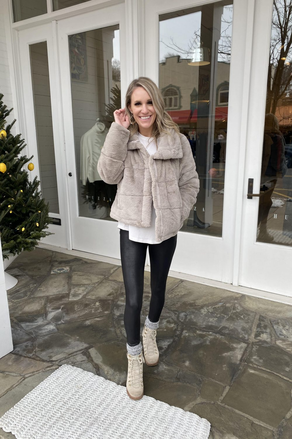 fashionable woman in tan fur winter coat outfit
