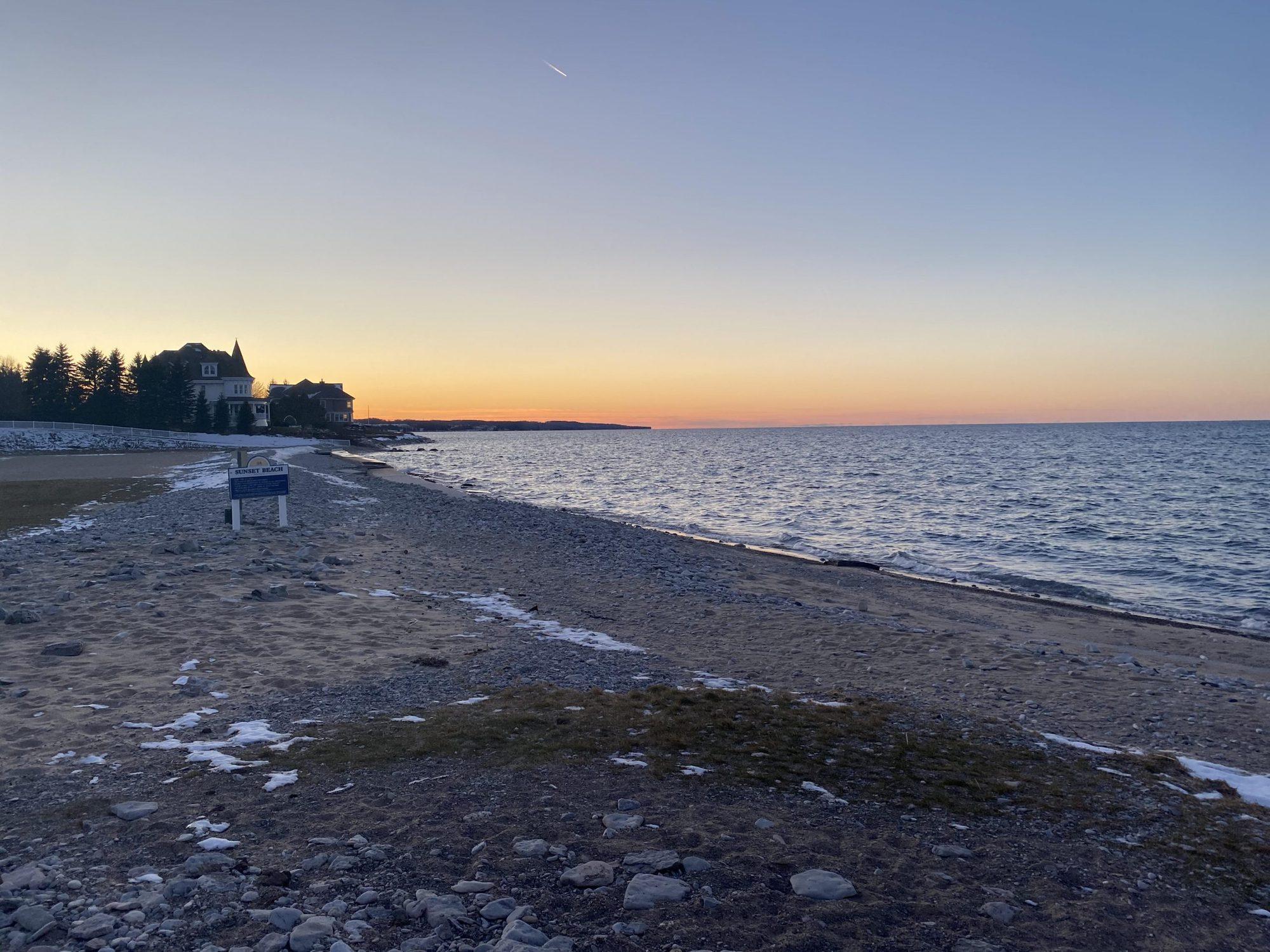 winter sunset over Lake Michigan |Inn at Bay Harbor by popular Michigan travel blog, The House of Navy: image of Sunset Beach Michigan.