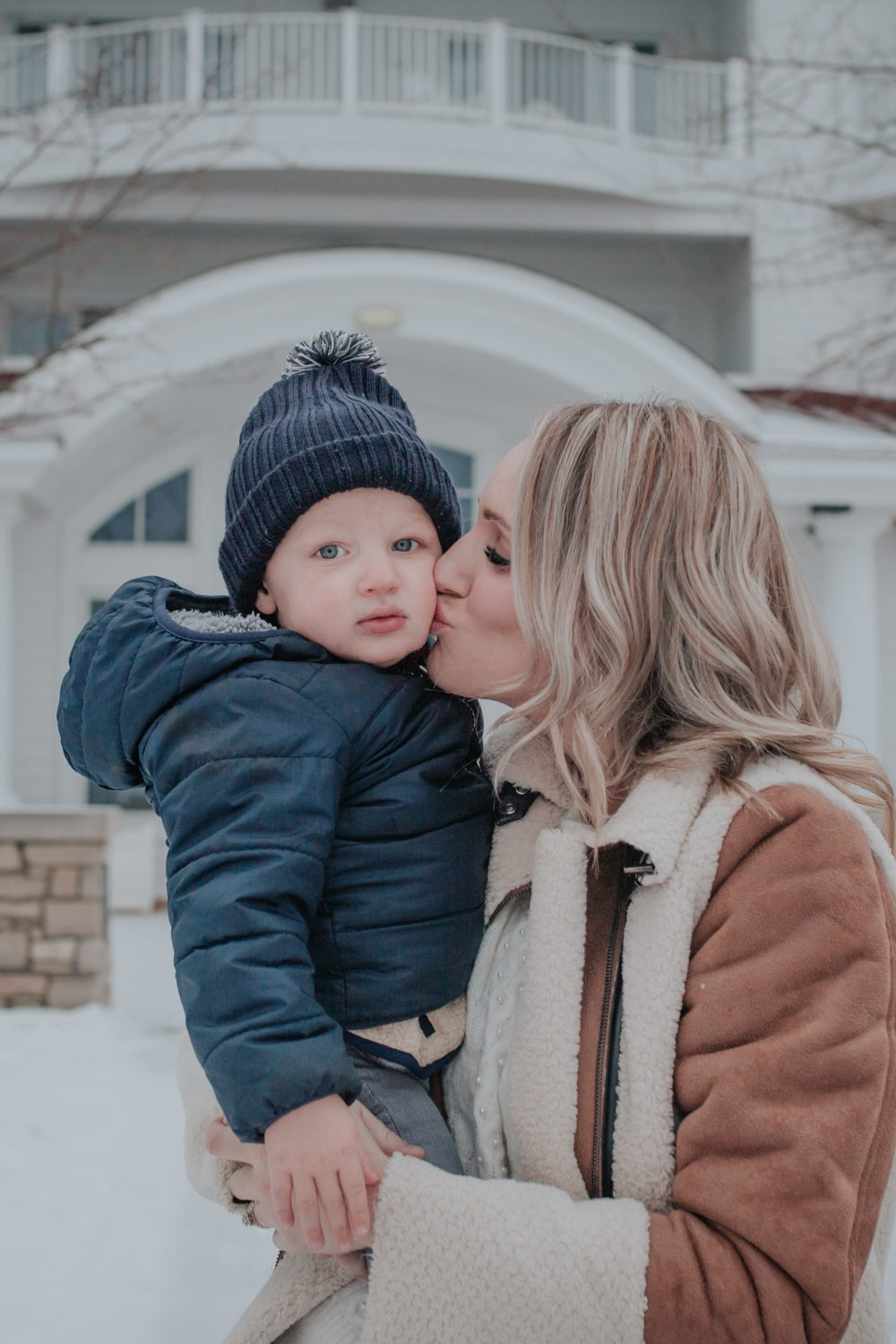 5 Benefits of Getting the Flu Vaccine in Michigan featured by top MI lifestyle blogger, House of Navy: mom holding toddler son and kissing his cheek