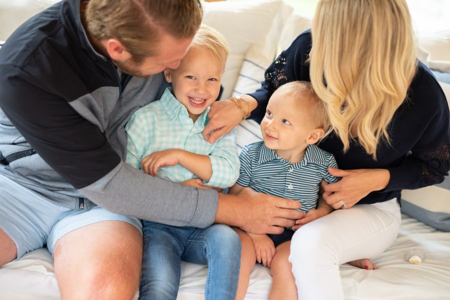 family with two boys laughing